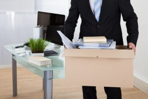 Man removing belongings in box from office