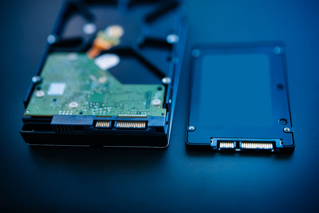 hard disk next to ssd disk (solid state drive) blue technological background