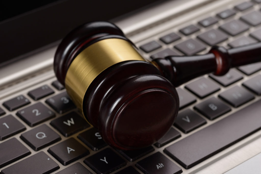 Close-up of wooden gavel on laptop