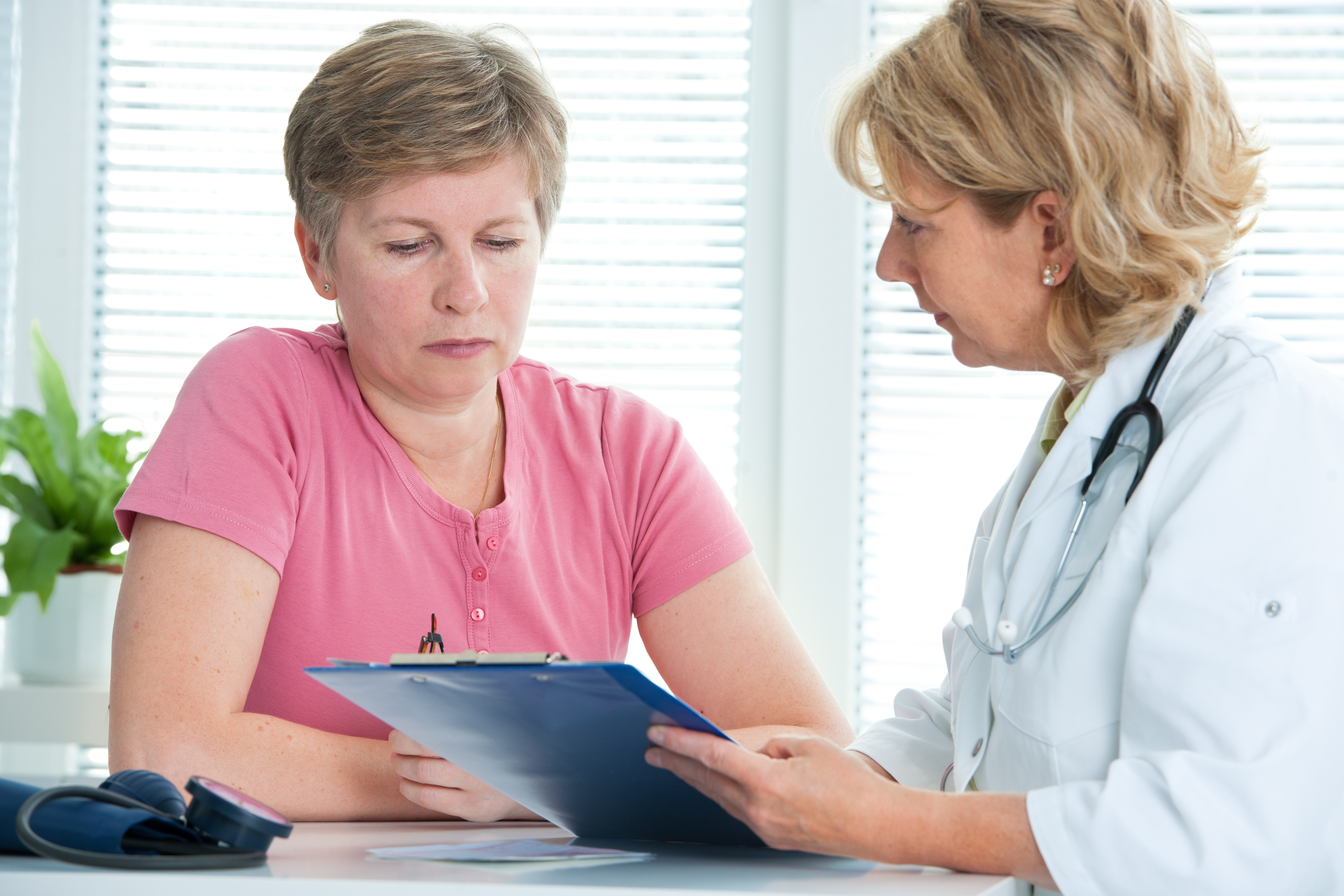 physician discusses test results with her female patient