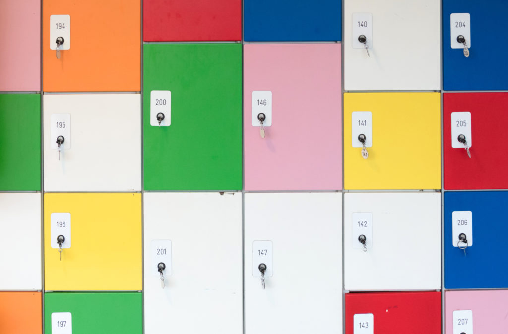 Colored locker file cabinets with keys attached to locks