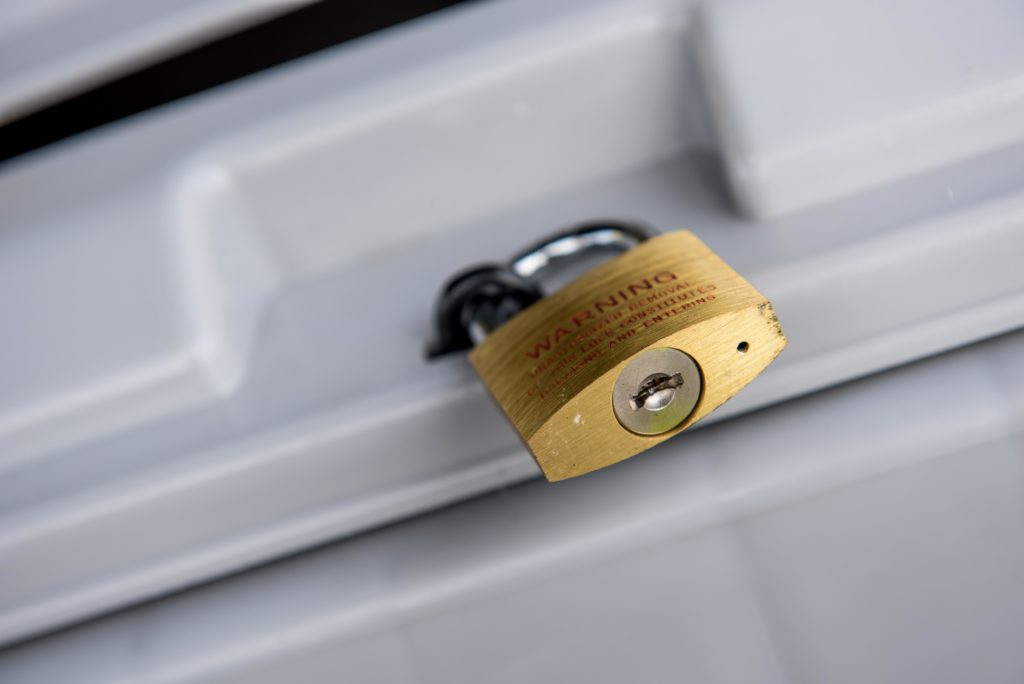 Gold lock on a shredding bin cybersecurity