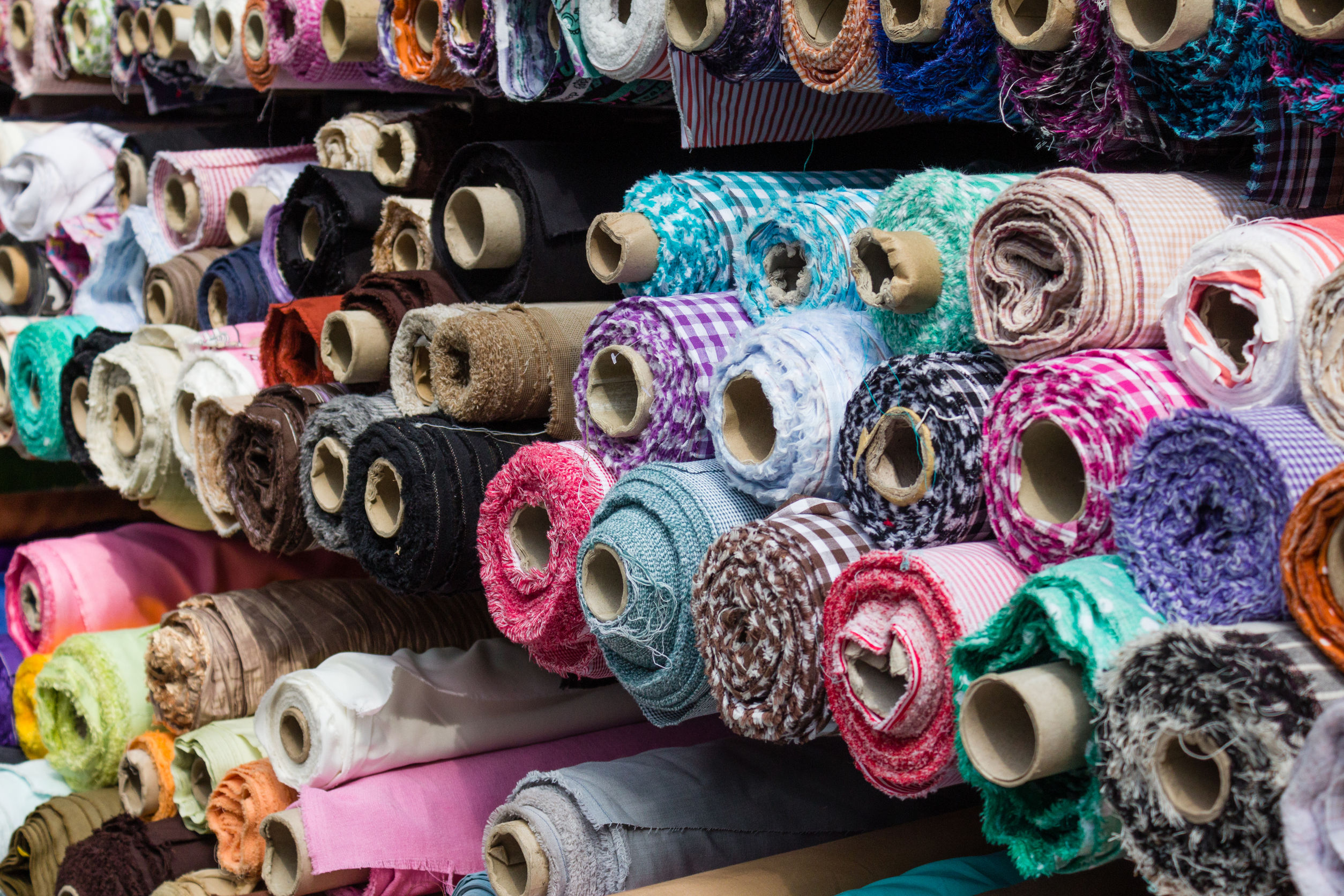 fabric rolls at market stall